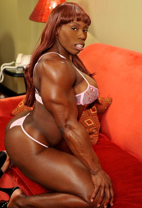 Nude black female muscle mistress — photo 14
