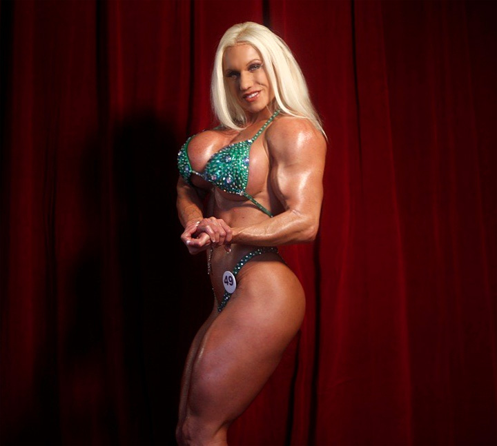 Blonde sexy female bodybuilder in see through top works out - 4 1