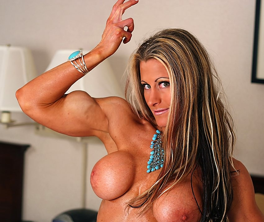 Naked muscle girl in bed