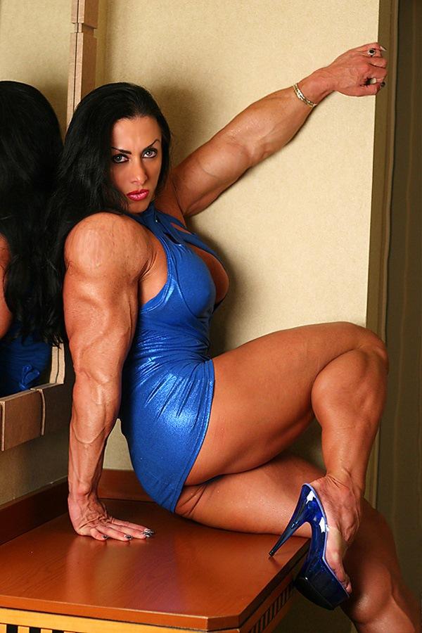 Muscular Brunette Mistress Flexing Her Big Hard Biceps -5582