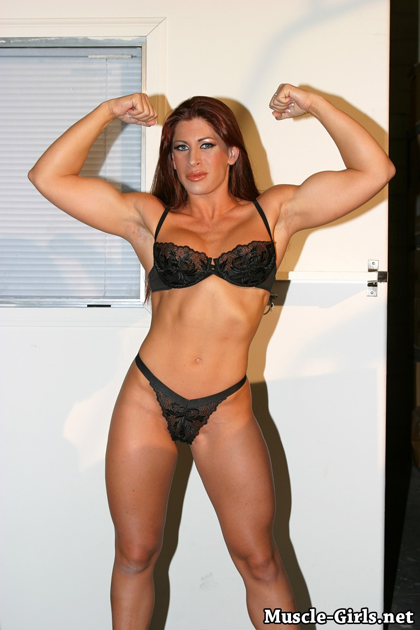 Sexy fitness goddess with strong muscles posing-966
